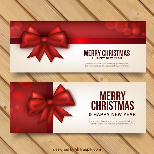 Feliz Natal e novos banners anos com fitas vermelhas Vetor grátis