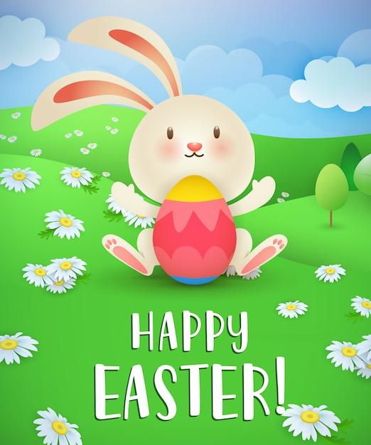 Feliz páscoa lettering, coelho, ovo e gramado com margaridas Vetor grátis