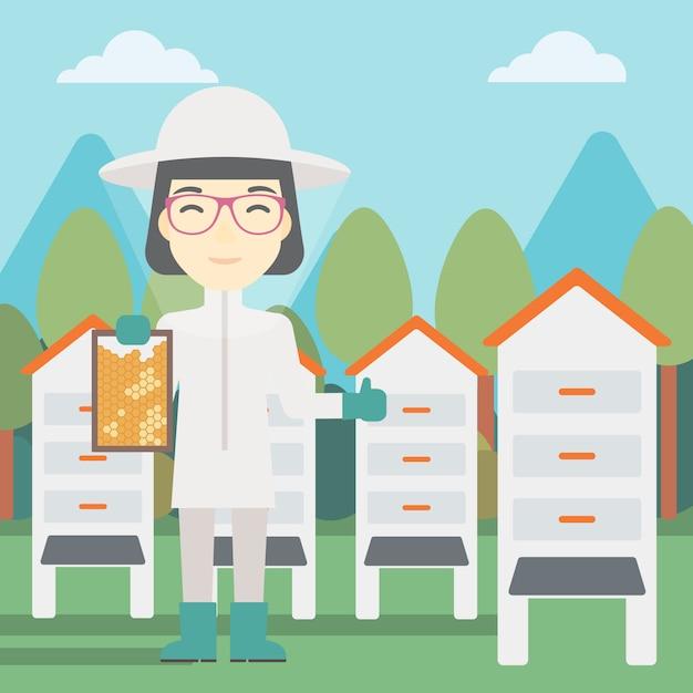 Feminino apicultor no apiário Vetor Premium