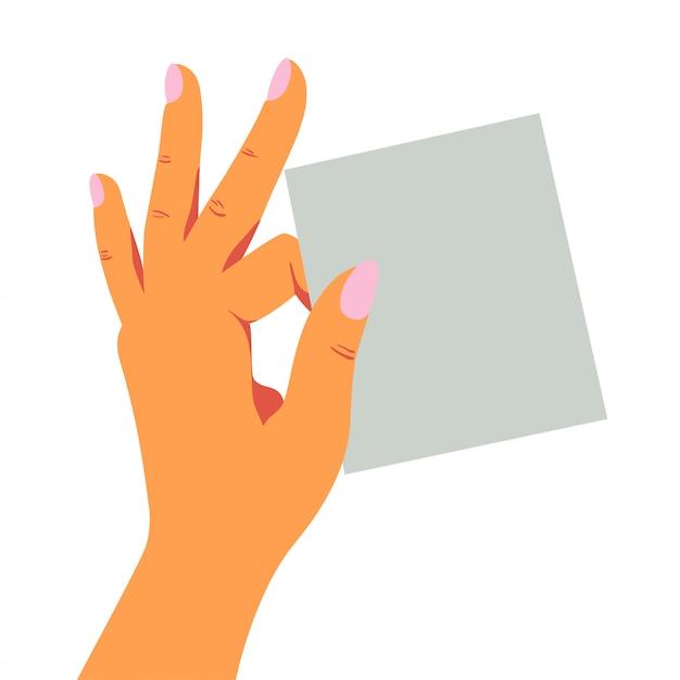 Feminino mão divertidamente detém uma folha em branco de papel de nota com dois dedos. Vetor Premium