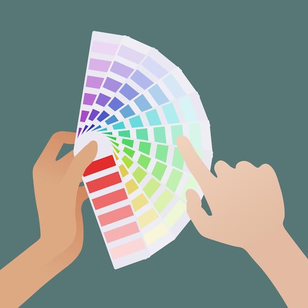 Feminino mão segurando o guia de cores e mão masculina pálida escolhe a sombra Vetor Premium
