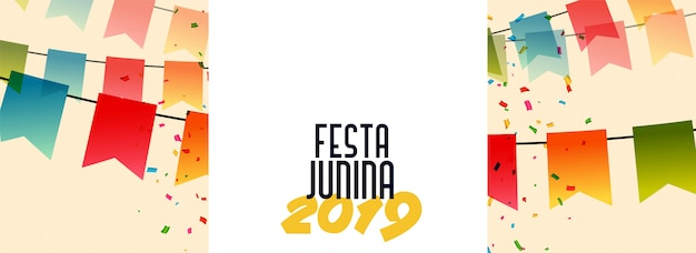 Festa junina 2019 banner com bandeiras e confetes Vetor grátis