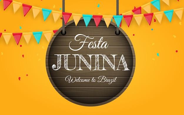 Festa junina fundo com bandeiras de festa. fundo do festival de junho do brasil para cartão, convite de férias. Vetor Premium