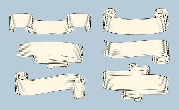 Fitas antigas de papiro ou pergaminhos enrolados Vetor Premium