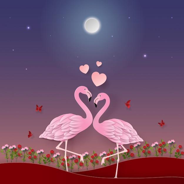 Flamingos no jardim Vetor Premium