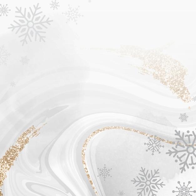 Floco de neve dourado sobre fundo de mármore Vetor grátis