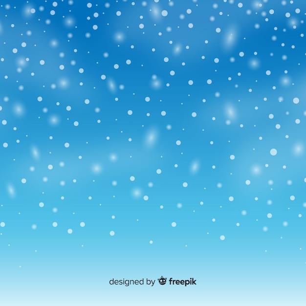 Flocos de neve caindo realistas no fundo do céu Vetor grátis