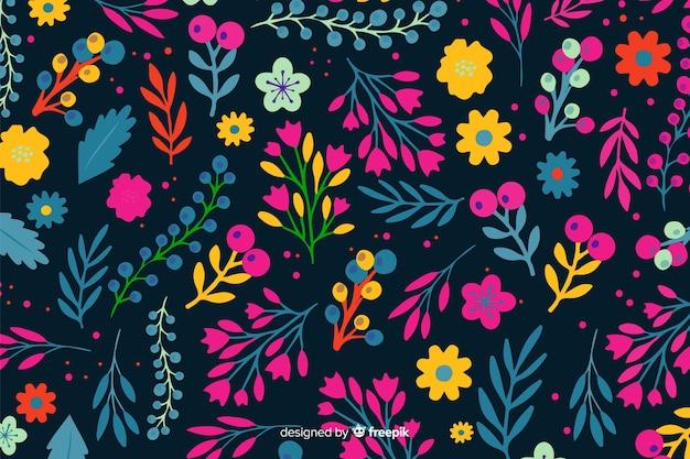 Flores coloridas decorativas e fundo de folhas Vetor grátis