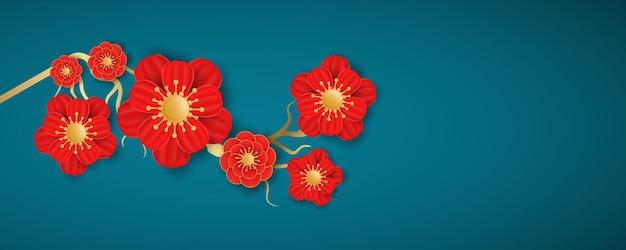 Flores desabrochando em um fundo azul. decoração para o ano novo chinês. Vetor Premium