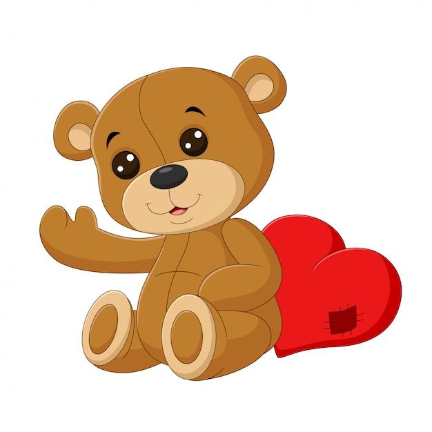 Fofo urso de pelúcia com coração vermelho Vetor Premium
