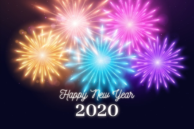 Fogos de artifício coloridos ano novo 2020 Vetor grátis