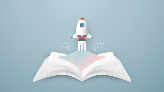 Foguete sobe do livro aberto. Vetor Premium