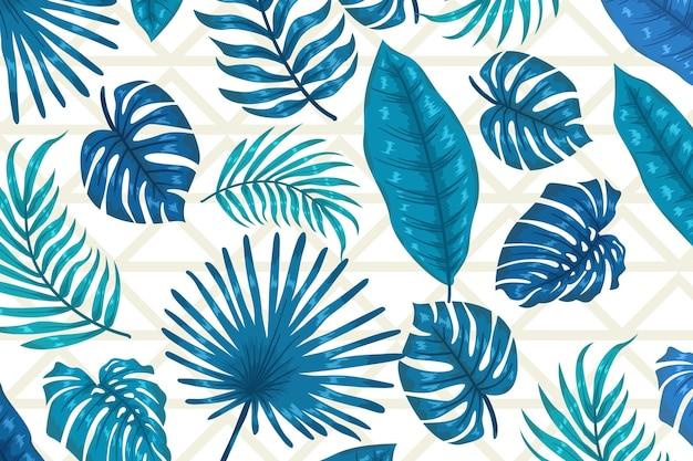 Folhas azuis com fundo geométrico Vetor grátis