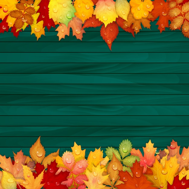 Folhas coloridas em fundo de madeira Vetor Premium