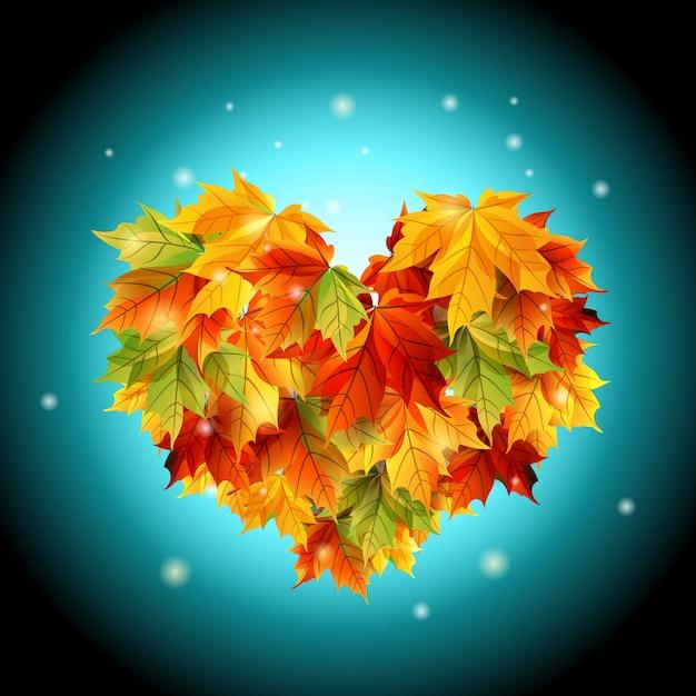 Folhas de osennikh coração sobre um fundo azul Vetor Premium