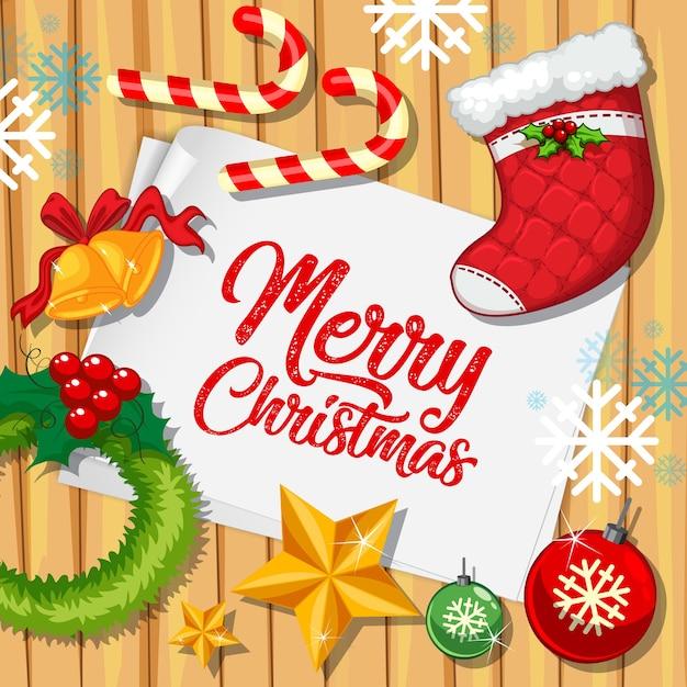 Fonte de feliz natal no papel com objetos de natal vista de cima Vetor grátis