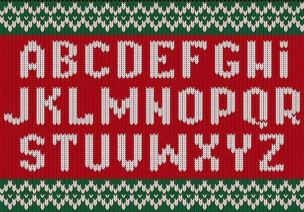 Fonte de malha. alfabeto de natal para letras de suéter de festa de tecido com textura étnica. Vetor Premium