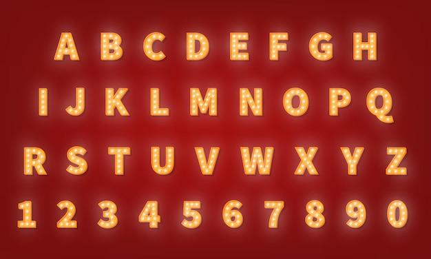 Fonte de tipografia ouro retrô de cassino. alfabeto lâmpada Vetor Premium