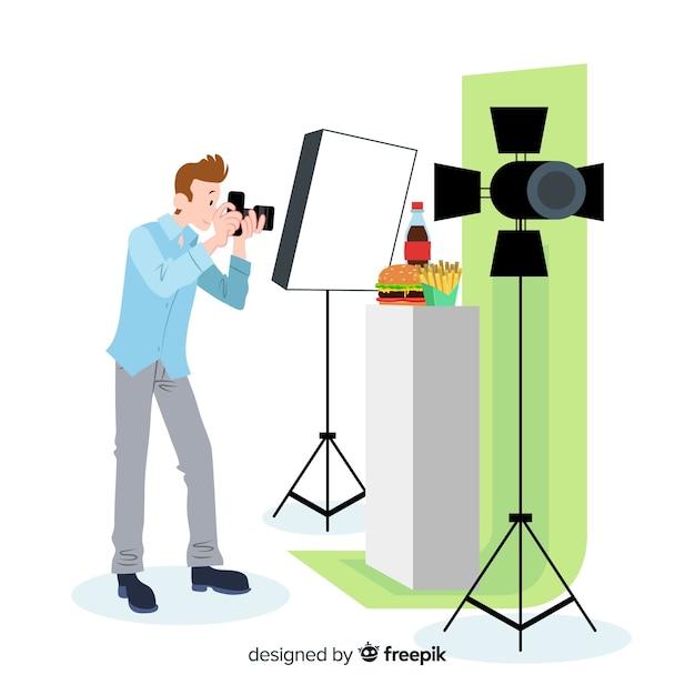 Fotógrafo de design plano tirando fotos no estúdio Vetor grátis