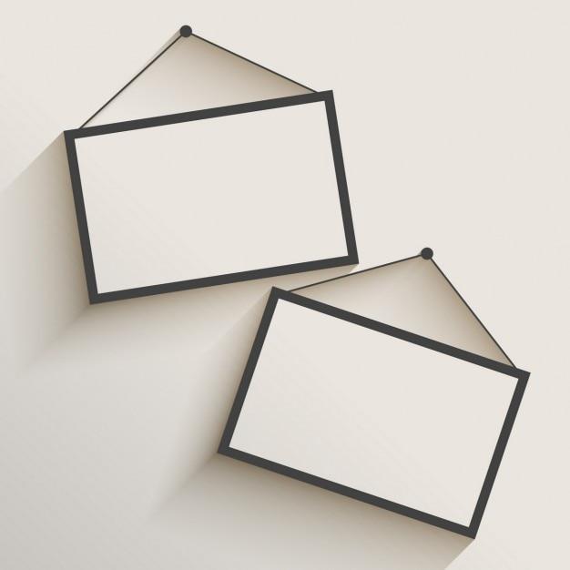 frame em branco da foto que pendura na parede Vetor grátis