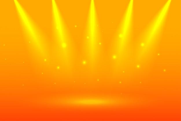 Fundo amarelo brilhante com holofotes de foco Vetor grátis