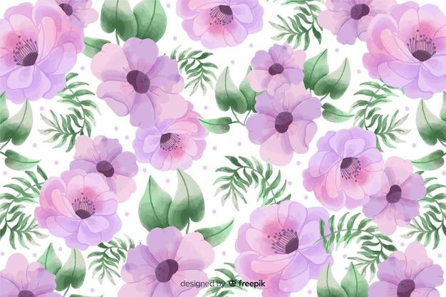 Fundo aquarela com lindas flores e folhas Vetor grátis
