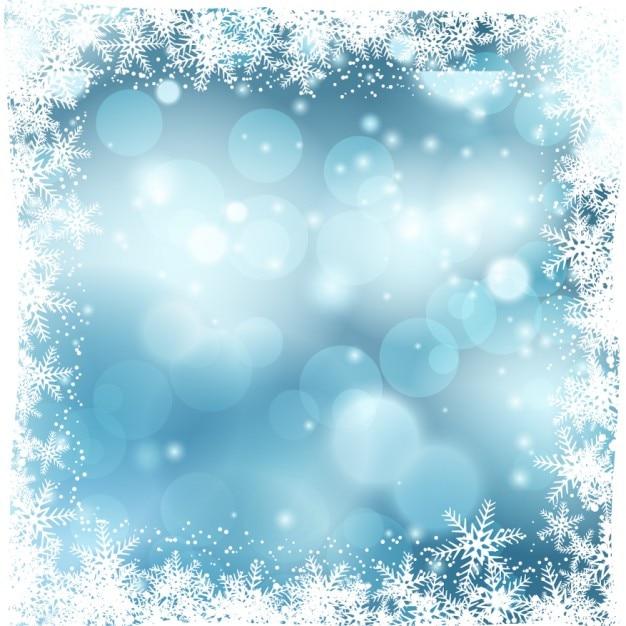 Fundo azul bokeh com flocos de neve | Baixar vetores grátis