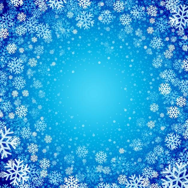 Fundo azul com flocos de neve, cartão de felicitações Vetor Premium