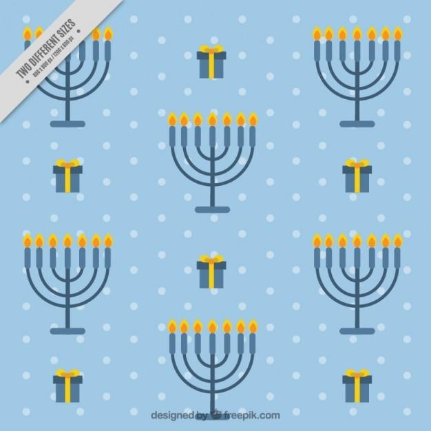 Fundo azul de hanukkah com candelabros e presentes Vetor grátis