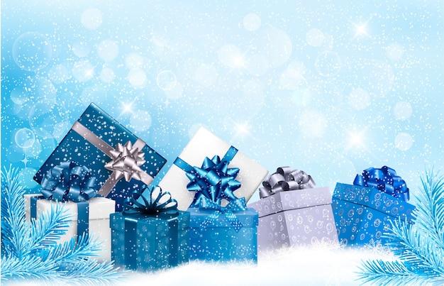 Fundo azul de natal com caixas de presente e flocos de neve Vetor Premium