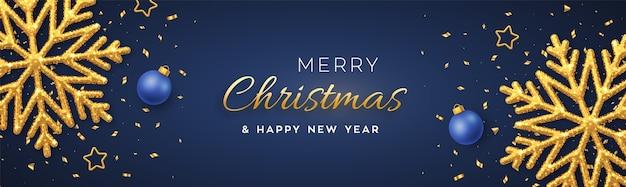 Fundo azul de natal com flocos de neve dourados brilhantes, estrelas e bolas douradas Vetor Premium