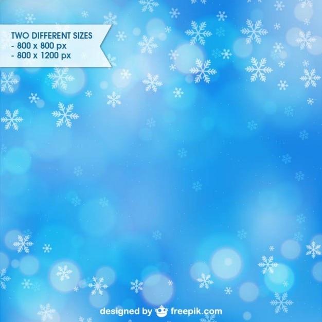 Fundo azul do inverno com flocos de neve Vetor grátis