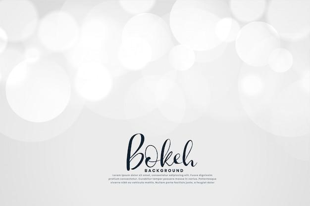 Fundo branco com efeito de luzes de bokeh Vetor grátis