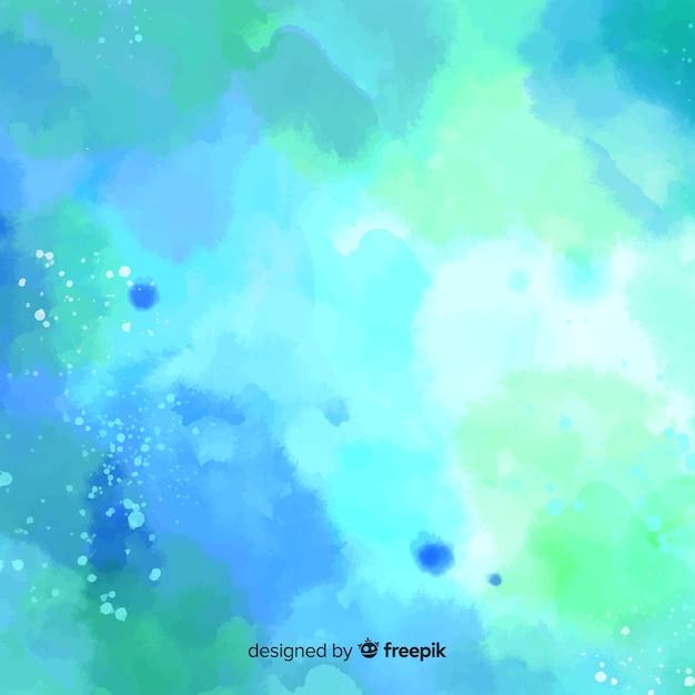 Fundo colorido de aquarela com manchas Vetor grátis