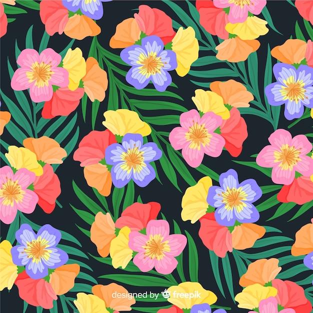 Fundo colorido padrão de flor tropical Vetor grátis