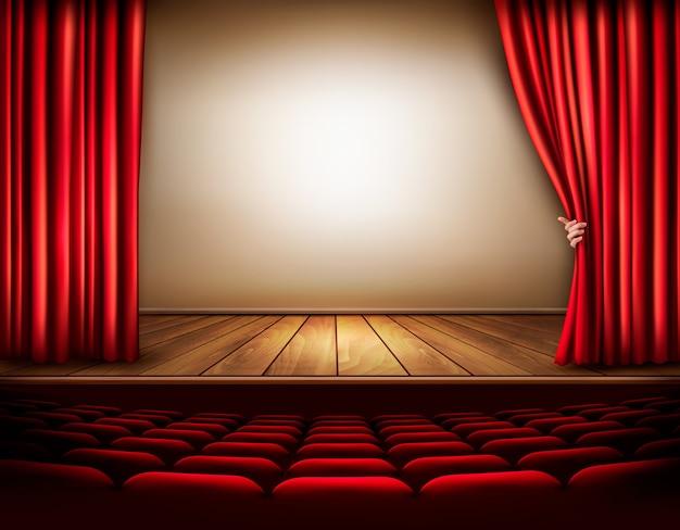 Fundo com cortina de veludo vermelho e mão. ilustração Vetor Premium