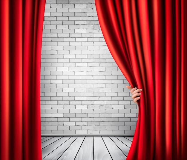 Fundo com cortina de veludo vermelho e mão. Vetor Premium