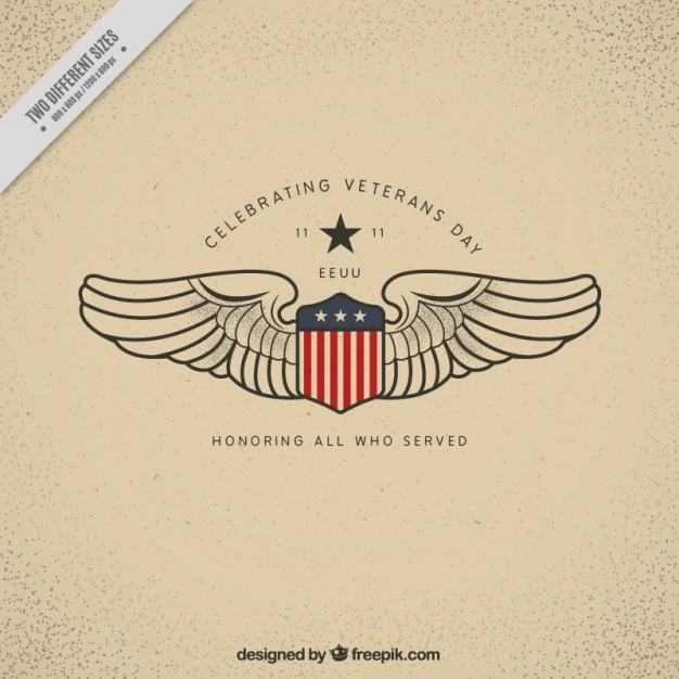 Fundo com um escudo e duas asas para o dia dos veteranos Vetor grátis