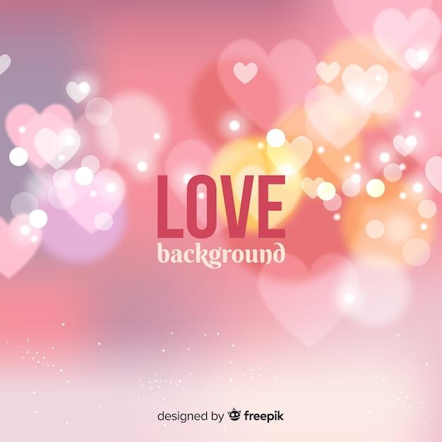 Fundo de amor de corações turva Vetor grátis