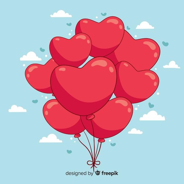 Fundo de balões de coração desenhado de mão Vetor grátis