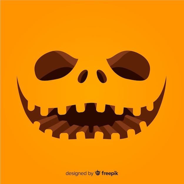 Fundo de cara de abóbora de halloween Vetor grátis