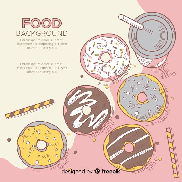 Fundo de comida com deliciosos donuts Vetor grátis