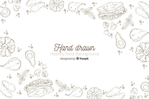 Fundo de comida saudável de mão desenhada Vetor grátis
