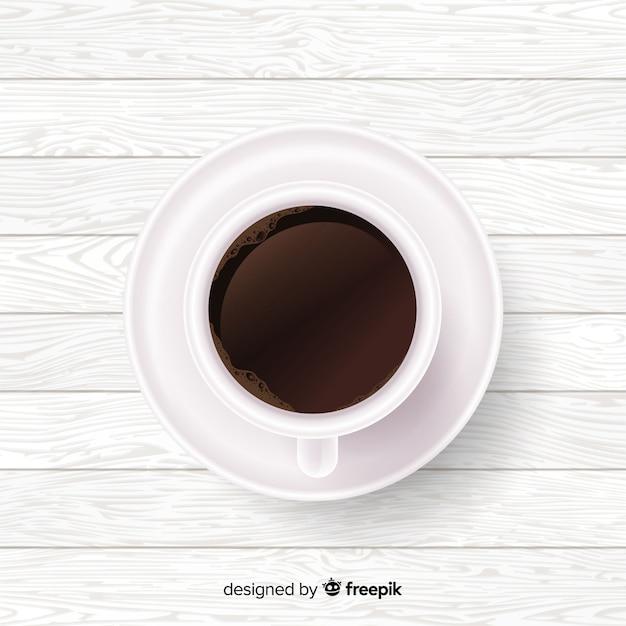 Fundo de copo de café realista Vetor grátis