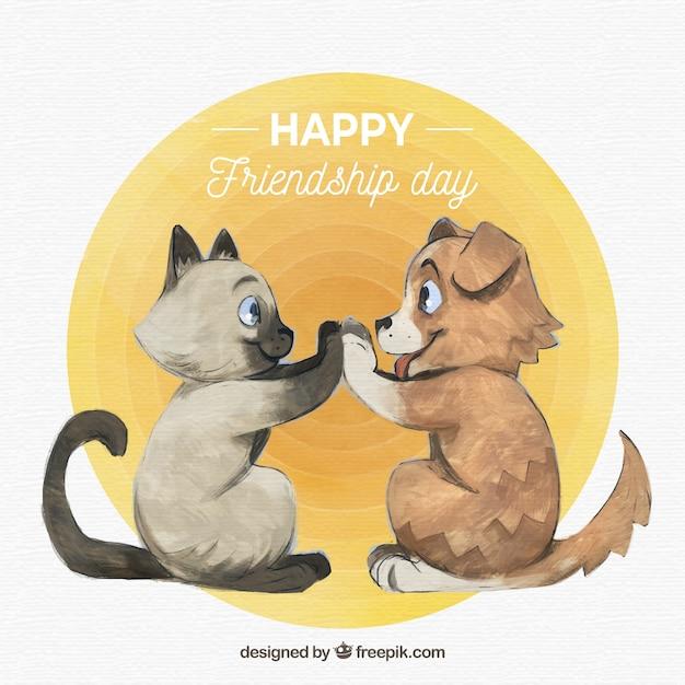 Fundo de dia de amizade com giro mão desenhado gato com cachorro Vetor grátis