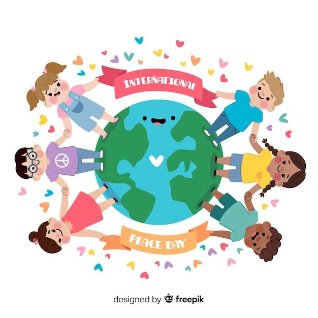 Fundo de dia de paz com as crianças de mãos dadas ao redor da terra Vetor grátis