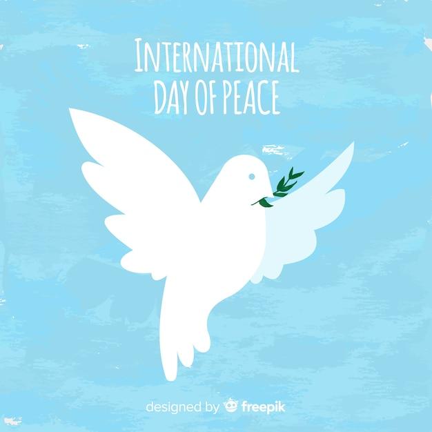 Fundo de dia de paz em aquarela com pomba branca Vetor grátis