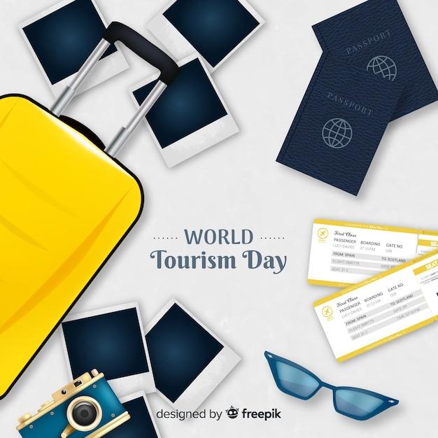 Fundo de dia mundial do turismo com bagagem, passaporte e fotos Vetor grátis