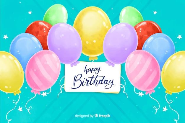 Fundo de feliz aniversário em estilo aquarela Vetor grátis