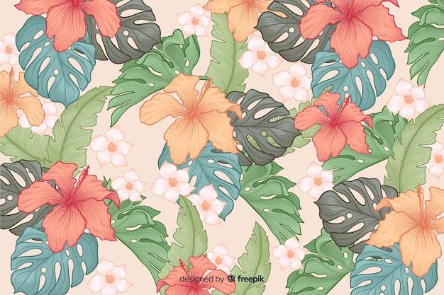 Fundo de flores tropicais de mão desenhada Vetor grátis